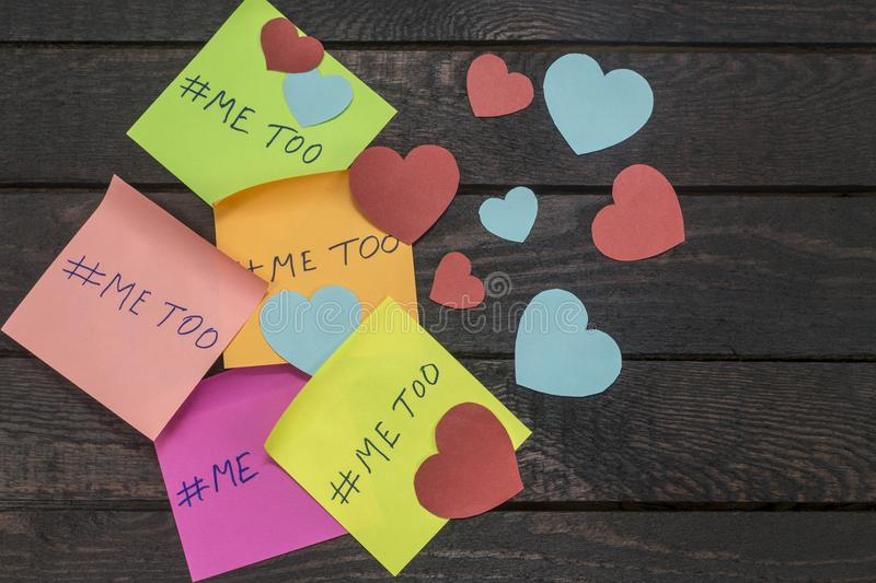 Me Too hashtag on colorful note papers, anti sexual harassment social media campaign.  stock photos