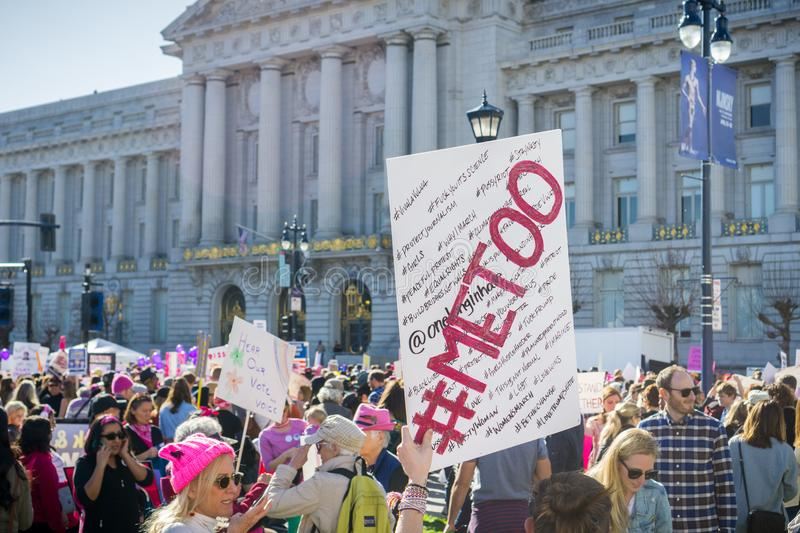`Me too` sign raised high by a Women`s March participant royalty free stock photography