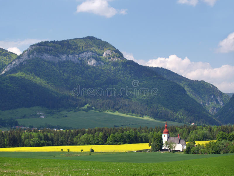 Meadow and church of Saint Ladislav stock images