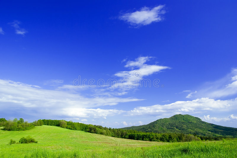 Meadow with clouds. Photo of meadow with clouds royalty free stock photo