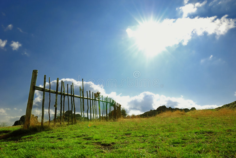 Meadow With Fence And Blue Sky Stock Image
