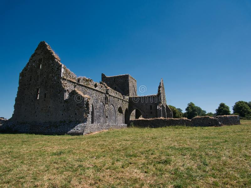 Meadow in front of the Hore Abbey on a sunny day royalty free stock photography