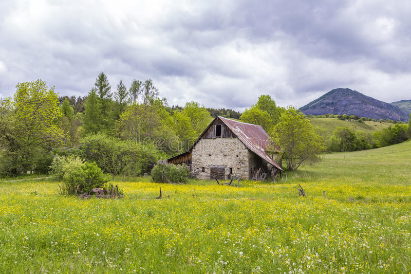 Meadow with hut near le Vernet at col Mirabeau. Green meadow with hut near le Vernet at col Mirabeau stock image