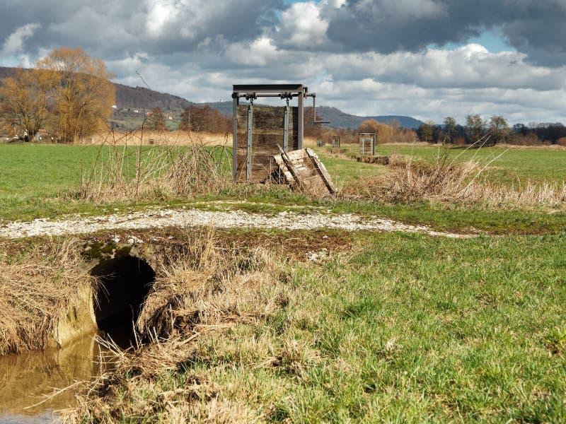 Meadow irrigation weir near Forchheim Franconia, Germany. Typical Bavarian Franconian landscape meadow irrigation system Southern Germany royalty free stock photography