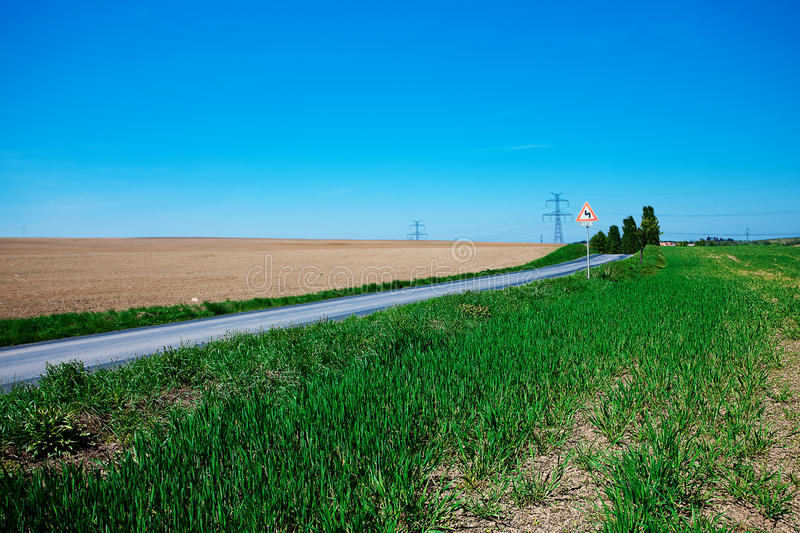 Meadow And Power Line Stock Photography