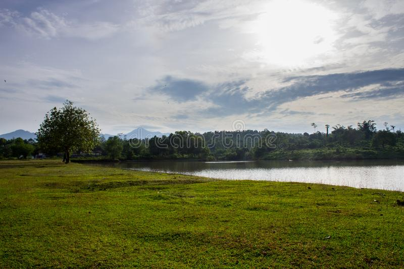 Meadow, Sky, And Lake royalty free stock photography