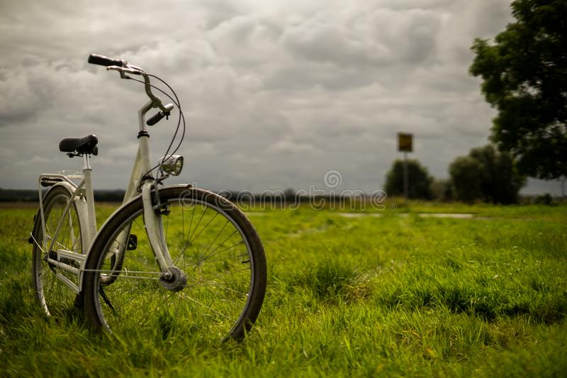 Bike standing in the meadows royalty free stock image