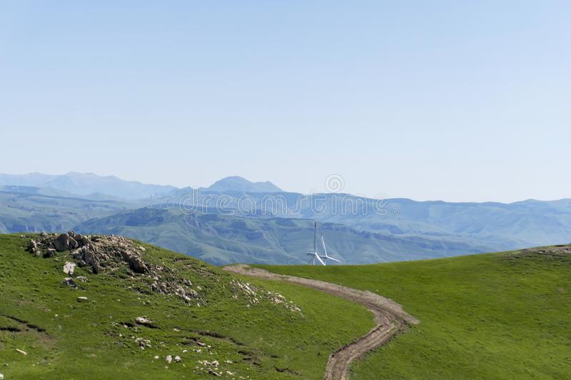 Meadows and country road, the top of the mountain scenery. stock photos