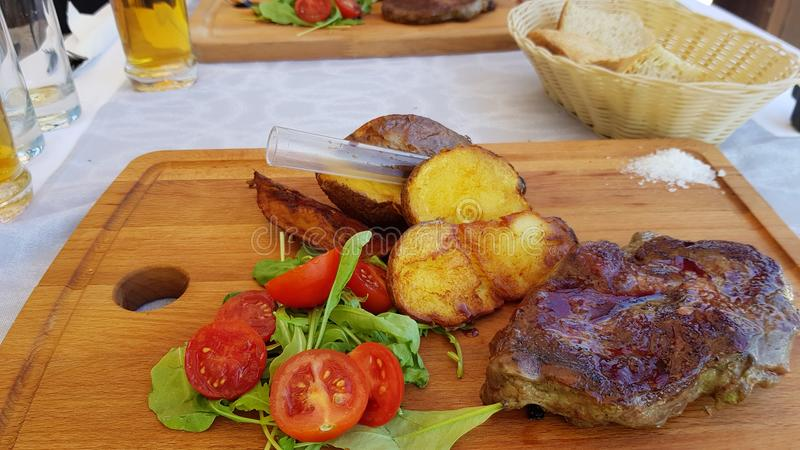 A meal in Croatia presented on a wooden board royalty free stock photography