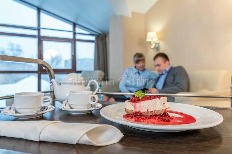 Meal delivery in room. Cake and utensils for tea. Meal delivery in room. Image of dessert and utensils for tea break stock photography