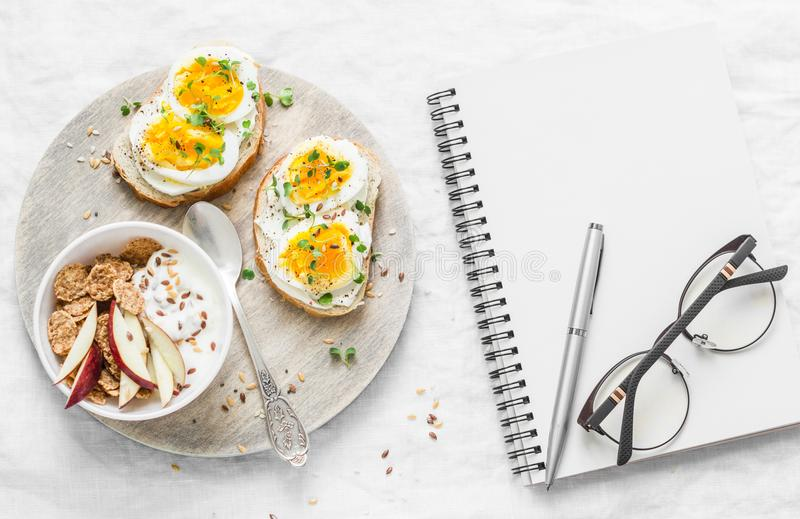 Meal diet plan. Healthy breakfast or snack - sandwiches with soft cheese and boiled egg, greek yogurt with whole grain cereal, fla. X seed, apples and clean stock images