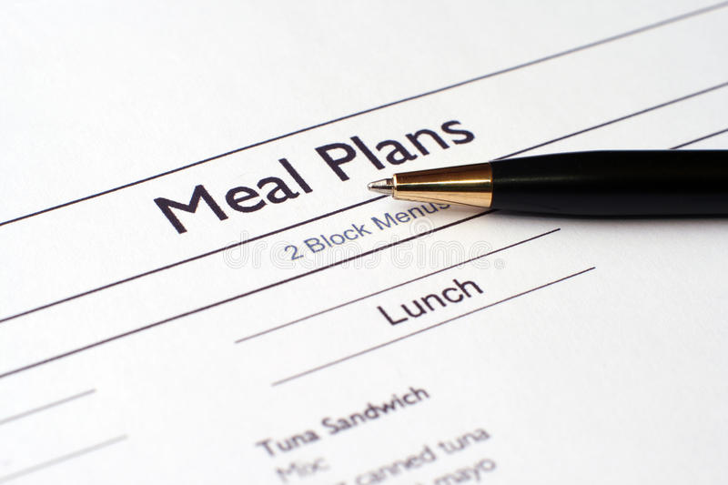 Meal plans. Close up of pen on meal plan royalty free stock photos