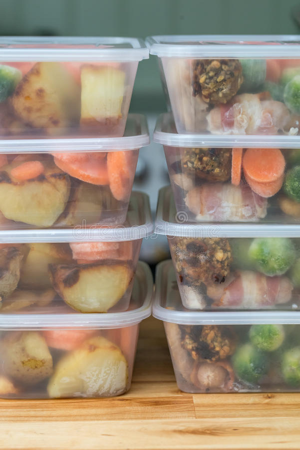 Meal prep. Stack of home made roast dinners. Vertical. Meal prep. Stack of home cooked roast chicken dinners in containers ready to be frozen for later use stock photo