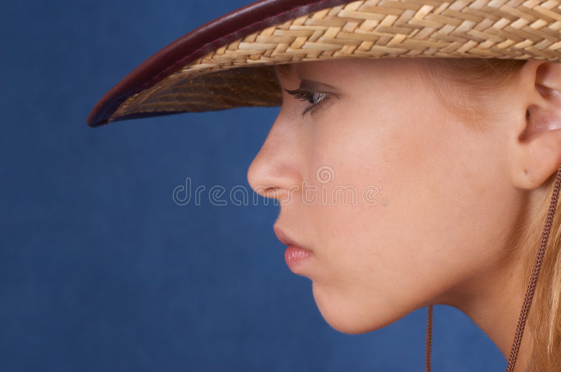 Mean cowgirl. In a cawboy hat stock photography