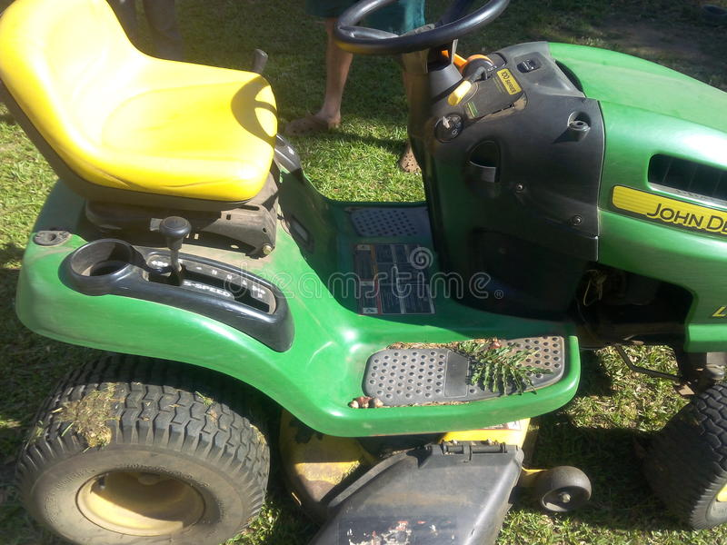 Mean green grass cutting machine royalty free stock image