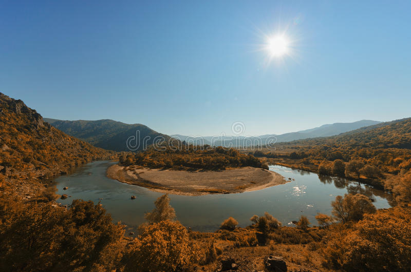 Meandering river in autumn stock photo
