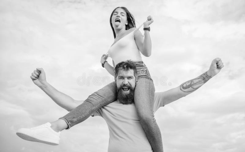 They are meant to be. Loving couple happy smile having fun. Bearded man piggybacking his girlfriend just for fun. They are meant to be. Loving couple happy smile stock images