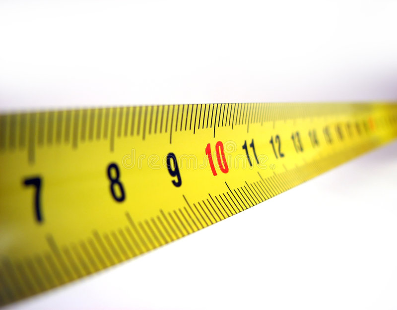 Meassuring meter. Isolated measuring tape in yellow stock images