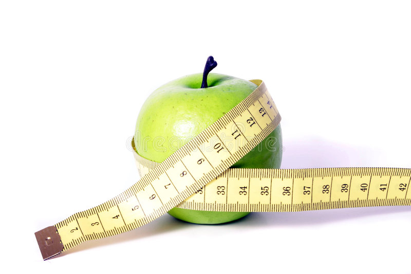 Measure tape and apple. A metaphorical image showing an apple measured with a tape, showing healthy diet, on a white background royalty free stock images