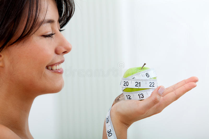 Download Measure Tape Around An Apple Stock Photo - Image: 15132014