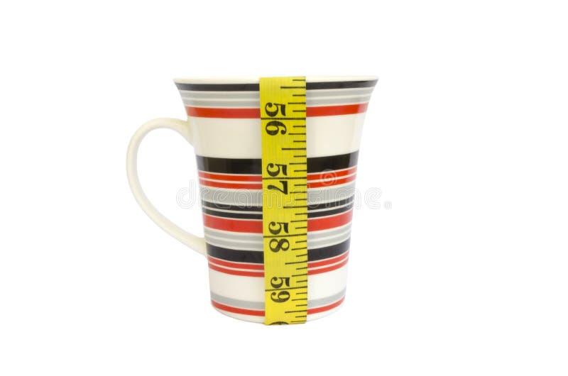 Measure tape and coffee mug royalty free stock image