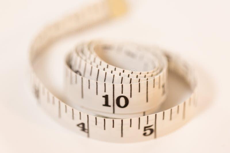 Measure tape white on white background.  stock photos