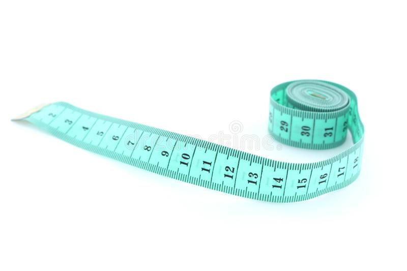 Measure tape on white background. Measure tape on a white background stock images