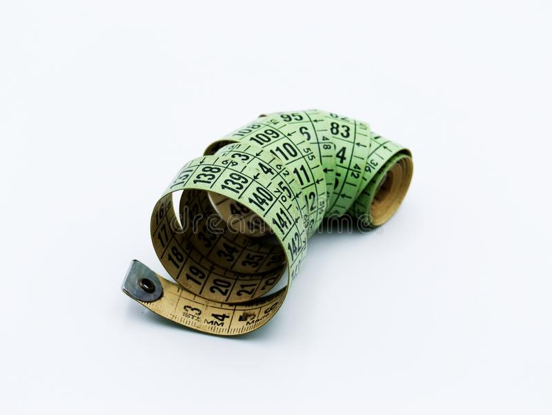 A measure tape on a white background royalty free stock image