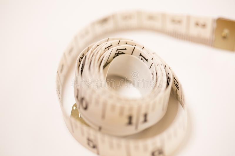 Measure tape white on white background.  royalty free stock images
