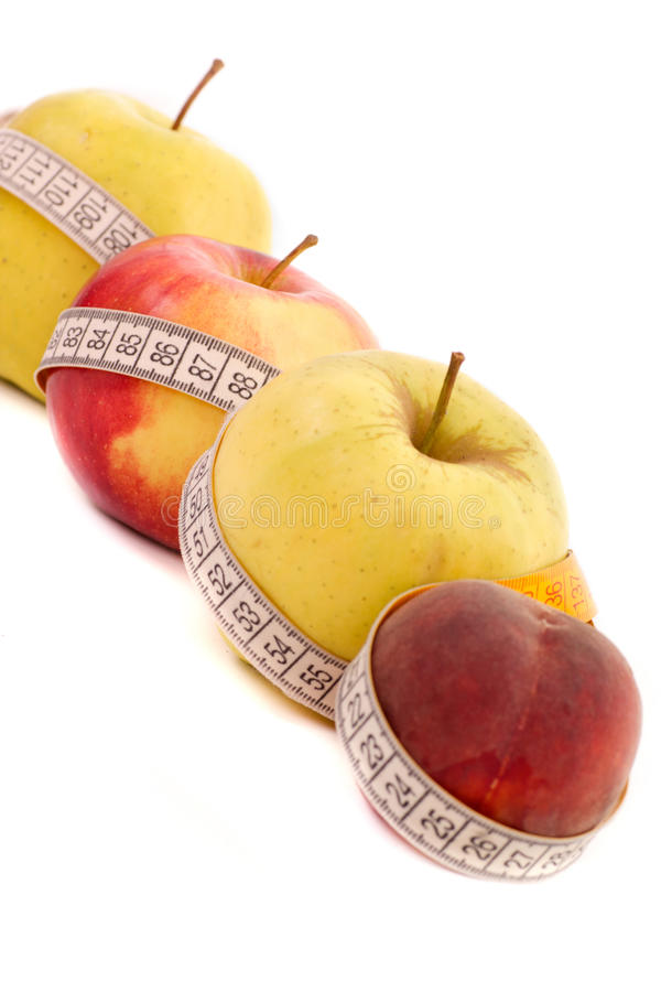 Measurement Of Apple And Peach Stock Image