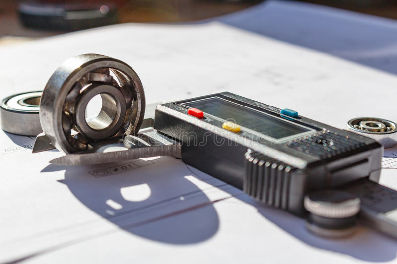 Measurement of the ball bearing width by a digital caliper stock image