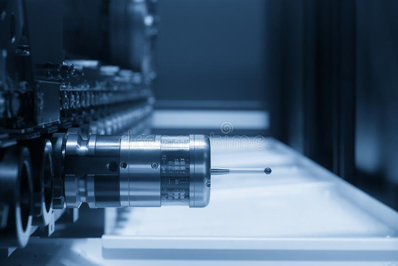 The measurement probe. For measure the sample part on the CNC machine in the dark scene stock photography