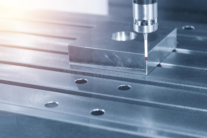 The measurement probe. For measure the sample part on the CNC machine with the light blue scene royalty free stock image