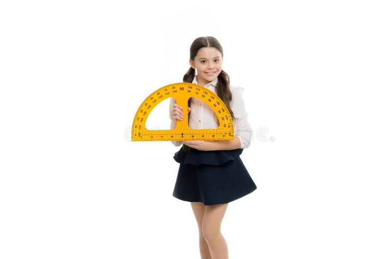 Measuring angles. An important lesson. Little girl preparing for geometry lesson. Cute schoolgirl with measuring royalty free stock images