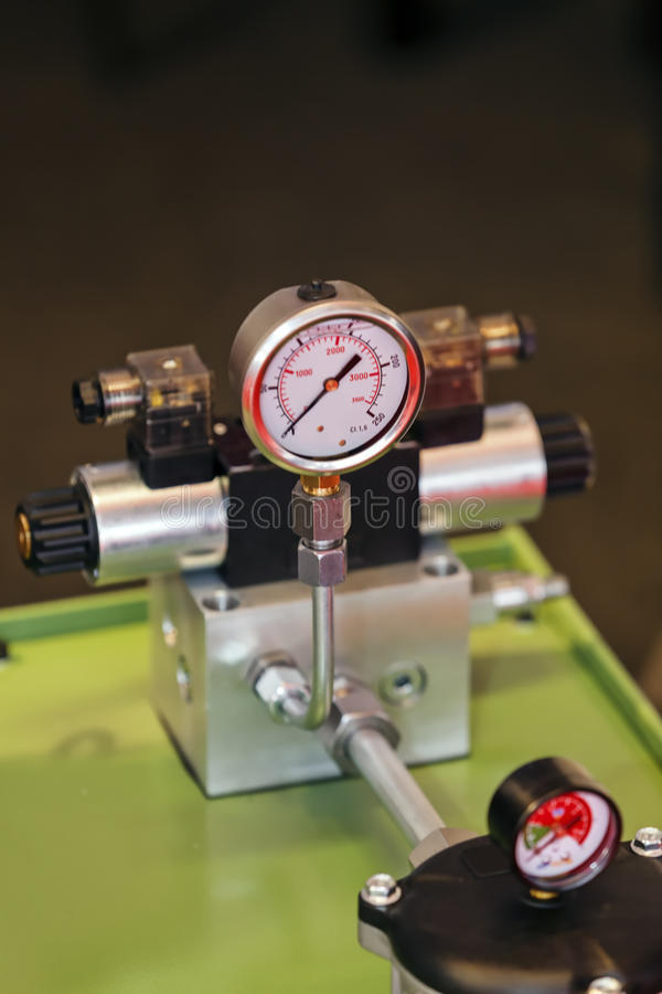 Measuring apparatus device. Focus on measuring apparatus device of engine for industry; note shallow depth of field stock photography