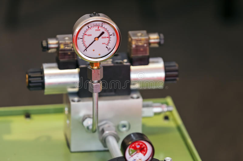 Measuring apparatus device. Focus on measuring apparatus device of engine for industry; note shallow depth of field stock photos