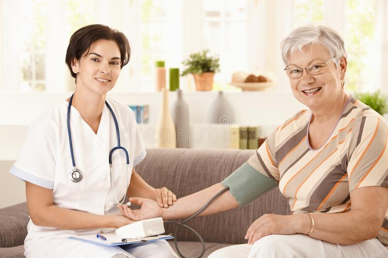Download Measuring blood pressure stock image. Image of happy - 18216193