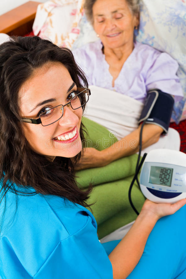 Measuring Blood Pressure with Digital Device royalty free stock photo