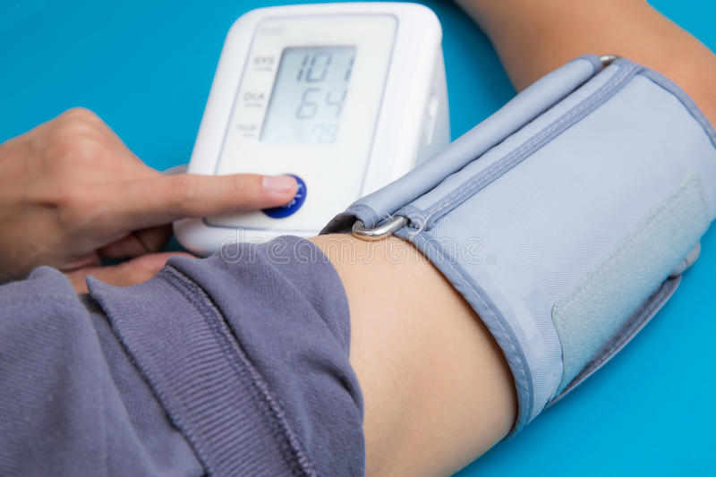 Measuring blood pressure royalty free stock images
