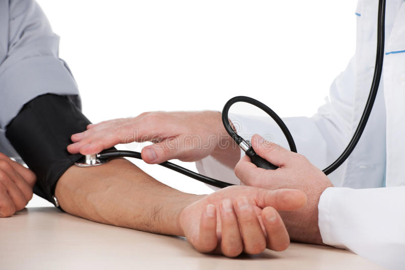 Measuring blood pressure. stock photos