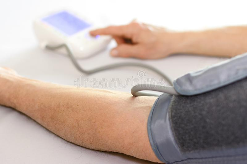 Measuring blood pressure stock images