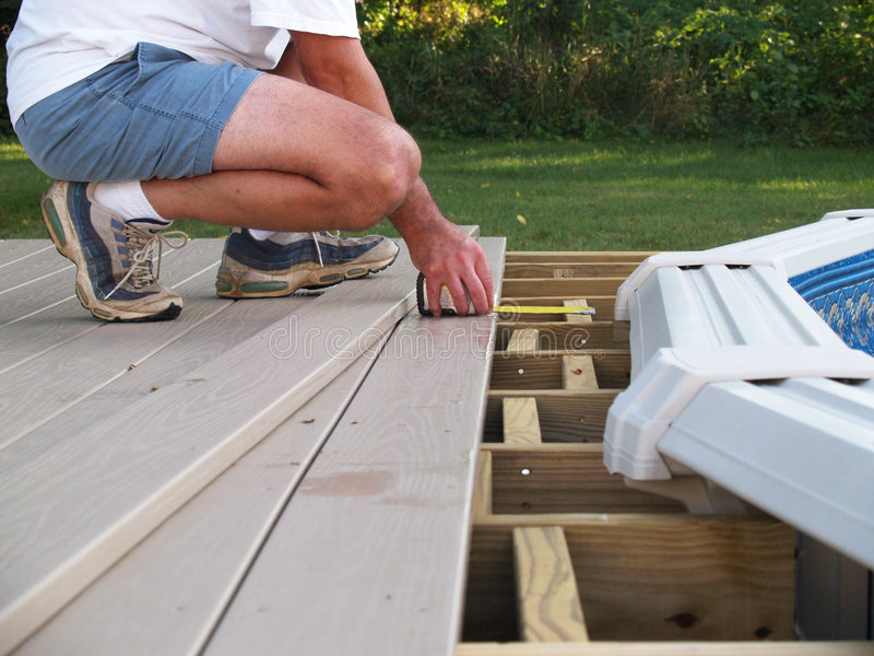 Measuring boards for a new pool deck stock photo