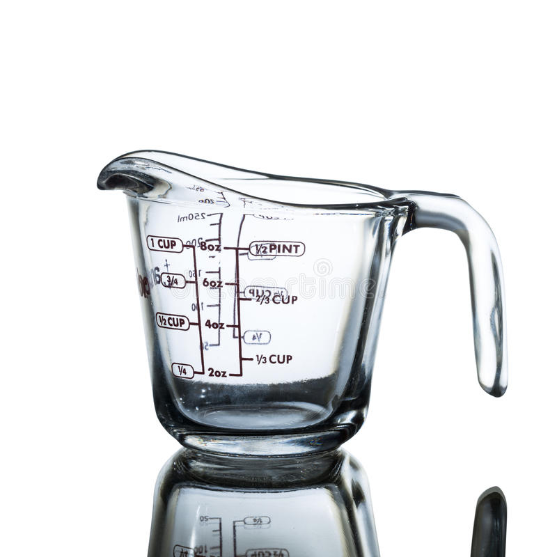 Measuring cup. Isolated on white background royalty free stock photo