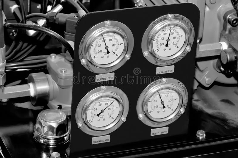 Measuring device with manometers. Black and white toned. Measuring device with manometers and connecting pipes. Black and white toned image stock image