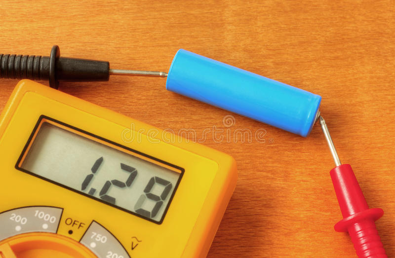 Measuring with digital multimeter stock images