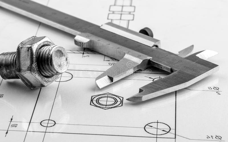 Measuring and drawing instruments and old drawings royalty free stock images
