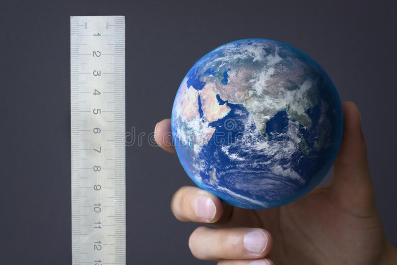 Measuring the earth royalty free stock image