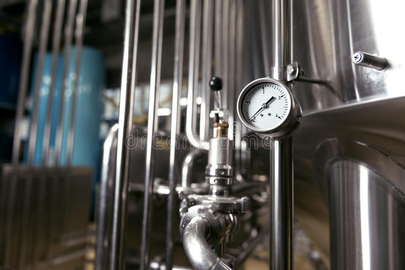 Measuring gauge being used in brewery royalty free stock photography