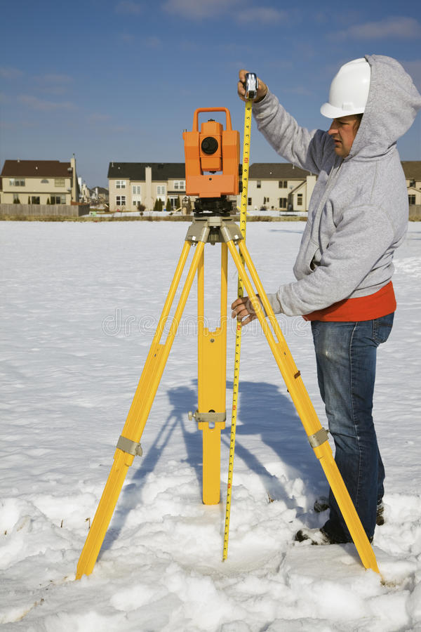 Measuring Height Of Theodolite Stock Photos