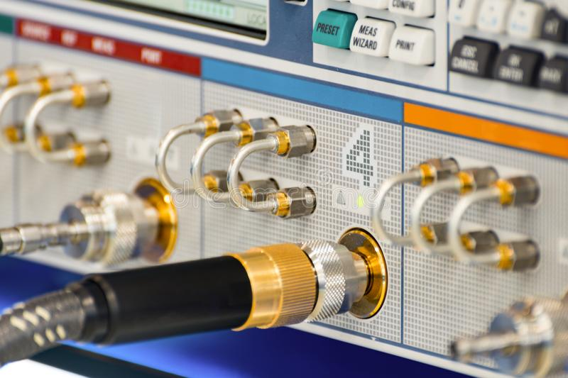 Measuring high-frequency equipment. Special high-frequency connectors are inserted into the instrument panel. royalty free stock photos